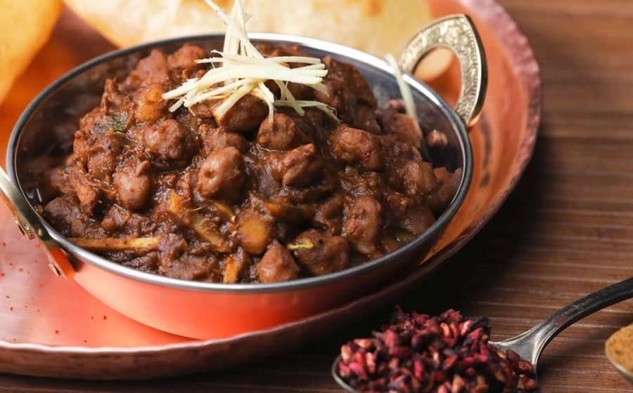 Make Punjabi-style dark and flavourful Amritsari Chole